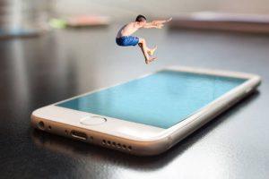man jumping phone